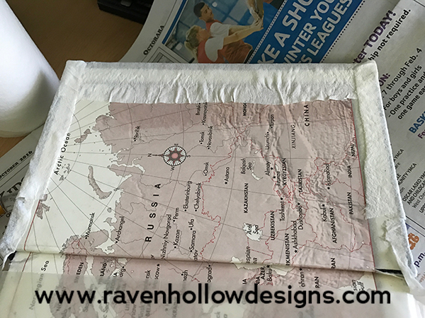 Wrap the edges of the paper towel to the inside of the cover